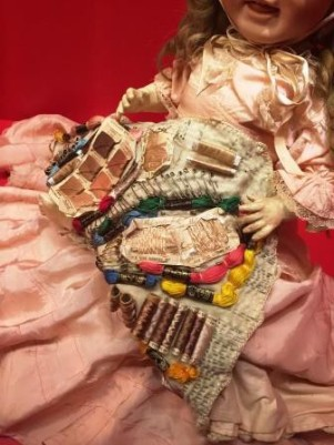 Repair kit concealed under porcelain doll's skirt