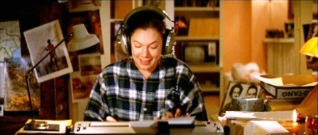 Kathleen Turner in Romancing the Stone, and me at my desk. Carrie Bradshaw we ain't.
